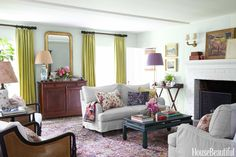 """Farrow & Ball's Skylight. """"A Colorful Character: A Los Angeles Cottage by Schuyler Samperton,"""" House Beautiful (October 2014): 84-93. A zesty mix of colors and patterns in paint and fabrics brought the living room to life and put an upbeat spin on traditional pieces. Walls are painted in Farrow & Ball's Skylight, and curtains are made of Rogers & Goffigon's Summerplace."""