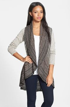Free shipping and returns on NIC+ZOE 'Cossack' Cardigan (Regular & Petite) at Nordstrom.com. An oval shape that sweeps from a wide shawl collar to a ruffled hem creates graceful lines for a cozy cardigan beautifully patterned in sophisticated neutral shades.