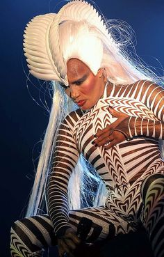 Grace Jones in costume designed by Eiko Ishioka, an Oscar-winning Surrealist Japanese costume designed who at age 73.