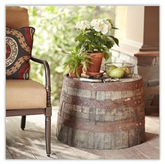 Outdoor Décor and Ideas upside down barrel  as a side table