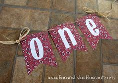 High chair banner/decoration for barnyard or farm first birthday party. Red bandanna print and raffia accents. Created by Banana Lala Party Designs
