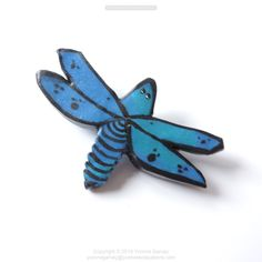 """Dragon flies are such an interesting bug with some unique wings.  I've seen some with translucent wings  Handmade from polymer clay, painted then varnished.  DESCRIPTION It is approximate 2"""" by 1 3/8"""" x 1/2"""" inch and weighs 4 grams. Materials: Polymer clay, acrylic paint, and a brooch pin.  Check out my website for more info by clicking on the photo. Price is only $12.00 free shipping in Canada, see wehbsite for details.   Copyright."""