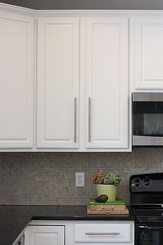 Wall sherwin williams crushed ice sw 7647 cabinets trim for Best paint for kitchen cabinets oil or latex