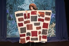 """Peter Quince (played here by Alysa King) performs the role of Wall in the Pyramus and Thisby """"play within a play"""" portion of A Midsummer Night's Dream.  This costume created by Jill Laplante is but one of the many wonderful pieces created or coordinated by one of Theatre by the Bay's long-time design pARTners."""