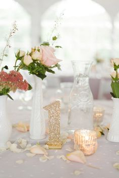 Give simple, neutral tablescapes a glitzy touch by using gold table numbers. Photo by Jeff Loves Jessica via Style Me Pretty