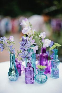 Saturated blue vases balance out the simple floral color palette of creams, whites, and neutrals | Brides.com
