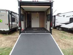 """2016 New Skyline Nomad 316SB Toy Hauler in Wisconsin WI.Recreational Vehicle, rv, Looking for a great toy hauler with a separate garage area for the toys that can be converted to additional sleeping? This one has a """"Happy Jack"""" Power Queen Bed in the garage that can be raised up out of the way when it's not needed and easily lowered to a convenient height when it is. The garage measures 91"""" wide x 10'-5"""" deep x 85"""" tall and has a retractable pull down screen for the loading ramp door when…"""