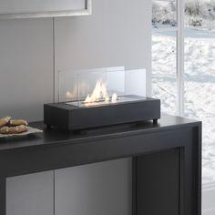 Caminetto a bioetanolo da tavolo con base rettangolare in metallo verniciato neroevetro temperato Bruciatore a doppio stratoda 1,5l e strumento di controllo della fiamma  Misure: 42cmx20cm h.22cm