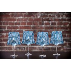 """ChaCha Blue Frosted Lumizu Wine Shades - Four Pack $12.95 Creating instant elegance is easy with LUMIZU Wine Glass Shades. These wine glass lamp shades are crafted from durable, frosted plastic and slide easily over water-filled wine glasses. No assembly required. LUMIZU Wine Glass Shades fit over any 12oz or 16 oz white wine glass (around 3.5"""" in diameter) Simply drop in the included water-activated, floating LED candles to bring a glow to any special day. OpenSky.com"""