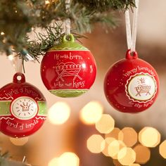 """HAPPY BIRTHDAY TO THE KING SET OF THREE ORNAMENTS    Item # 80354  These delightful, ceramic ornaments, with their contemporary flair, will brighten your tree and the faces of those who see them! Written on each ornament is a true and powerful message, accompanied by relevant artwork. The circumference of the circle measures 9 3/4"""". Each ornament hangs by a 4"""" organza ribbon."""