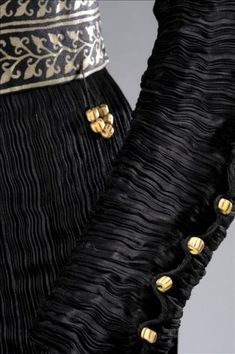 "MARIANO FORTUNY, Detail of 'The Secret of Delphos', one of the 130 pieces created by Mariano Fortuny y Madrazo, son of the great Fortuny, a versatile artist and cosmopolitan. They lay forgotten, until now, when his genius as a designer shined in an exhibition at the Museum of Costume in 2010, where under ""Inspirations,"" offered to the public some creations that combine some of its facets: painter, printmaker, photographer, portrait painter, textile and fashion designer."