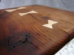 Tabouret en acier brossé et vieux bois.