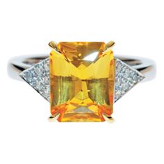 YELLOW SAPPHIRE AND DIAMOND RING  Inspired by the art-deco movement this vibrant yellow sapphire was featured in yellow gold claws between triangles of pave set diamonds. www.sdj.com.au