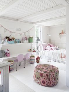 White washed and light-pink and white romantic girl's room