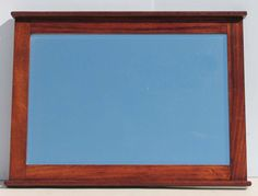Wall Mirror with Solid Wooden Frame Condition:  Used  Wall Mirror with Solid Wooden Frame  size: 1000 L x 760 H  R700  Cell 076 706 4700  Tel 021 - 558 7546  www.furnicape.co.za  0406 Frame Sizes, Decor, Wooden Frames, Mirror Wall, Headboard, Frame, Wooden, Wall, Home Decor