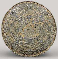 Italian, 16th Century, Shield from the Garniture Presented by the Duke of Savoy to King Philip III, Milan, c. 1585, etched, embossed, gilt, and gold-damascened steel; silver and fabric, Patrimonio Nacional, Real Armería, Madrid