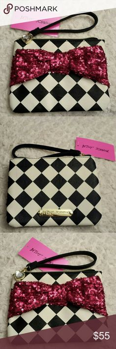 Betsy Johnson NWT Sequined Pink Bow Wristlet NWT Betsy Johnson Black and White Diamond Pattern With Sequined Pink Bow Wristlet,  Zippered top,  Zippered pocket inside Betsy Johnson  Bags Clutches & Wristlets