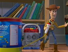 The books behind woody are titles of Pixar short films