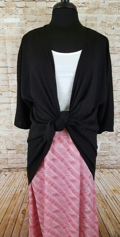 LuLaRoe Lucy skirt and a small black Lindsay!!  Lucy is an ankle length flowy skirt. Perfect for spring and summer. https://www.facebook.com/groups/MoniquesVIPLularoeBoutique/