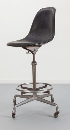 An Eames drafting chair that not only swivels, it also tilts!