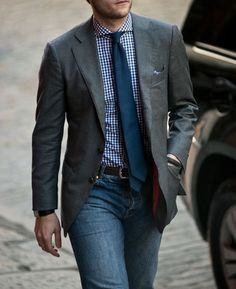 Grey Jacket, blue shirt, tie, and jeans