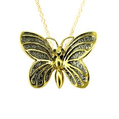 Butterfly with black diamond eyes in yellow gold with rhodium textured wings. http://www.londonroadjewellery.co.uk/yellow-gold-betterfly-black-diamond-pendant-necklace-1361