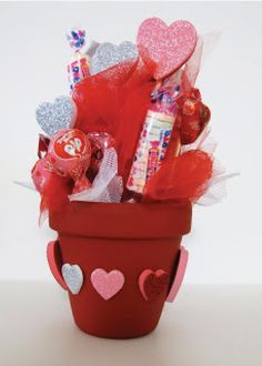 This awesome Valentine's Day flower pot will make a great gift for your kid's teacher! Let your child help pick out fun candy and decorations to make it extra special.
