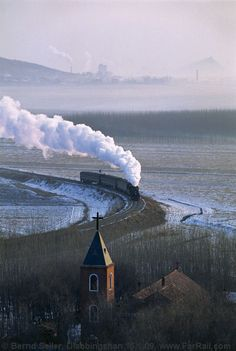 Steam train in Diaobingshan, China, January 2009.  Photo by Bernd Seiler. I wish I would have taken this picture.  That's the highest compliment I can offer up here.