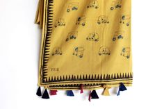 It's a Cotton hand block printed yellow dupatta with auto rickshaw print on it. With beautiful tussles on it #chhapa