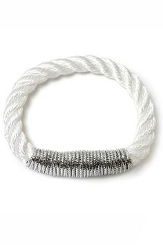 Bare and basic elegance. Without hardware, The Scarborough attracts a true rope enthusiast. The bangle's flexibility invites easy stacking with other pieces. Low-maintenance to the core, it goes seamlessly from one day's look to the next. Includes authentic The Ropes of Maine charm. 7mm White Twisted Rope Metallic Silver.    Small - 6 to 6.5 inch wrist Medium - 7 to 7.5 inch wrist   Ropes Scarborough Bracelet  by THE ROPES OF MAINE. Accessories - Jewelry - Bracelets Minnesota