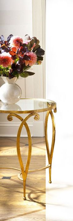 hand-wrought iron table with scroll design, antique gold leaf finish; hand-crafted tables inspiration