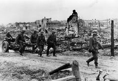 Battle of Stalingrad: German infantry redeploy a light gun during urban fighting, fall 1942. German infantrymen were poorly prepared for fighting amid ruins that created an often impassable terrain. Ironically, the Stalingrad necropolis was largely created by incessant German shelling and aerial bombing in the opening phases of the battle.