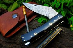 """DKC-34 OFFICER 8"""" Long 4.5""""Folded 5.7 oz Pocket Folding Damascus Knife DKC KnivesHand Made Incredible Look Feel. DKC-34 OFFICER 4.5"""" Folded 8"""" Open 5.7oz Black Buffalo Horn With Mosaic Pin Inlays. Sophisticated, cool, excellent hand and pocket feel. Compare to Knives 2 to 4 times the cost. HAND CRAFTED BY ARTISANS ! See our full line of DKC Knives TM. Knives Come With A Sheath Custom High Quality Double Layers of Hard Genuine Leather. The leather is water proof and has double layers…"""