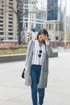 stripe shirt, long grey cardigan, round sunglasses