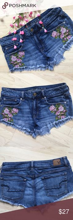"""AE floral embroidered distressed denim shorts Adorable factory distressed and frayed shorts from American Eagle. Adorable floral patches/embroidery! ~1.5"""" inseam, 8"""" rise and 31"""" waist. Fabric is 99% cotton and 1% spandex. In excellent condition. American Eagle Outfitters Shorts Jean Shorts"""