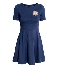 Dark blue. Short dress in thick jersey with an appliqué at front. Short sleeves…