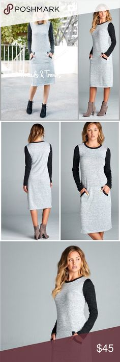 Color Block Hacci Knit Dress We love this beauty. Comfort meets style in the midi dress. Heather grey and black color block sleeves with a kangaroo pocket. The best comfy go to dress for any wardrobe. Sizes S, M, L, XL Threads & Trends Dresses