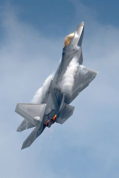 Raptor Ascending, F-22A Raptor at Robins AFB, showing afterburner glow and vapor trails on the airframe. Photo by Chris Buff.