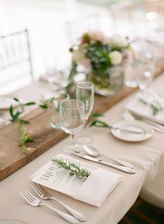 Rustic greenery accented place setting: http://www.stylemepretty.com/2016/04/18/a-rustic-wedding-at-the-grooms-family-farm/ | Photography: Elena Wolfe - http://elenawolfe.com/