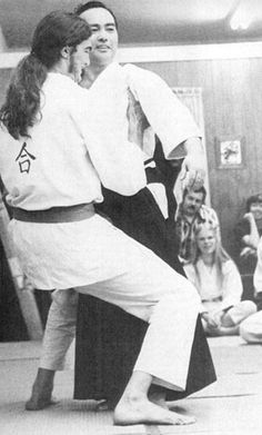 A young Steven Seagal attempts to lift Koichi Tohei, c. 1972