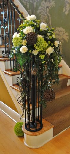 wedding flowers for staircase | Found on murphyweddings.wordpress.com