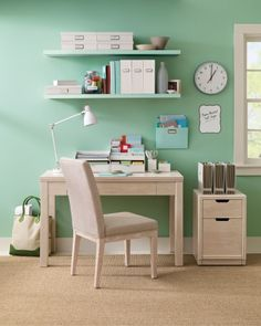 Martha Stewart Home Office- matching folders and boxes on shelves above desk, filing cabinet net to desk