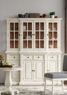 Sure to become a fabulous focal point in any room, the Genoa Hutch is a classic design that offers ample storage and display space. The hutch features beveled glass doors with dovetail drawers underneath, and solid mahogany construction.