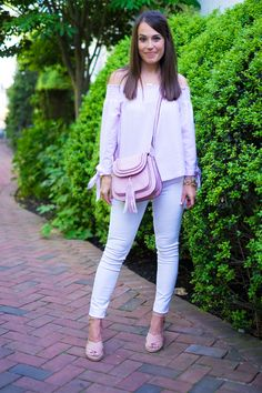 Pink on pink outfit on MrsCasual fashion blog. This tassel bag and off the shoulder top pair with white jeans and nude sandals for a perfect summer look!