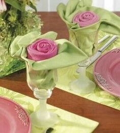 napkin folding from country woman magazine. very pretty pink and green rose and leaves napkins displayed in a glass.