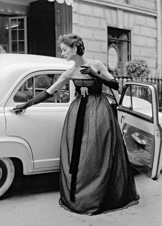 1951 ~ Model wearing an evening gown by Christian Dior