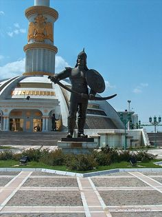 Monument to the Independence of Turkmenistan, Ashgabat. Ashgabat is the capital and largest city in Turkmenistan in Central Asia.  It is situated between the Kara Kum desert and the Kopet Dag mountain range. (V)