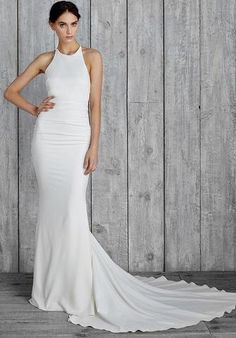 Nicole Miller Taylor is a simple bridal gown is made of crepe de chine, an airy and lightly textured silk. It features beaded Straps that go into the back of the gown with a halter neckline . This gown is brand new with tags. Nicole Miller Morgan is Antique White and a size 12.