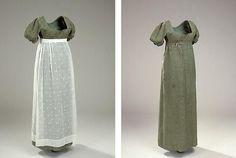 Lang kjole i blød, grøn nuance. Kjolen har højt liv og korte ærmer, samt et tyndt, hvidt forklæde.