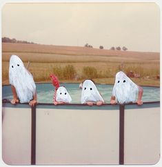 Ghost Photographs. Little paintings on found photographs by Angela Deane.